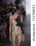 Small photo of A model walks the runway for Designer Melia Vijaya during the Indonesia Diversity Fashion Show Spring Summer 2018 New York Fashion Week at the Gallery Dream Downtown in New York on September 7th, 2017