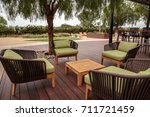 wood patio lounge chairs with... | Shutterstock . vector #711721459
