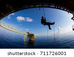 rope access job on the rig of... | Shutterstock . vector #711726001