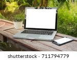 laptop on table. in the coffee... | Shutterstock . vector #711794779