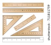 wooden metric imperial rulers.... | Shutterstock . vector #711811759