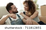 young couple sitting on couch... | Shutterstock . vector #711812851