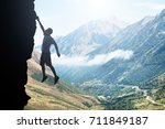 man without a net hanging over... | Shutterstock . vector #711849187