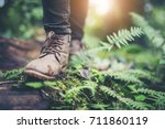 shoes man walking on a forest... | Shutterstock . vector #711860119