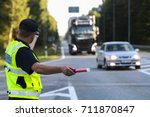 latvian police man is directing ... | Shutterstock . vector #711870847
