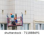 installers in the construction... | Shutterstock . vector #711888691