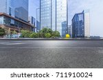 empty road with modern business ...   Shutterstock . vector #711910024