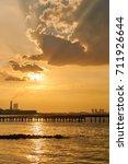 silhouette dock gold sunset... | Shutterstock . vector #711926644