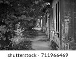 Small photo of Path to the Past. Old street`s sidewalk calling to come along.