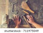 carpenter's little working... | Shutterstock . vector #711975049