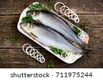 Stock photo delicious salted herring with onion on the old wooden background rustic style 711975244