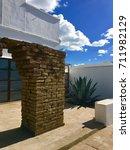 Small photo of Adobe Brick Art Installation Agave Courtyard Blue Sky Cloud in Marfa