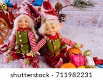 funny christmas elves sits next ... | Shutterstock . vector #711982231