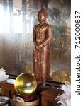 Buddha With A Gold Glass In Th...