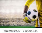 goalkeeper with a soccer ball... | Shutterstock . vector #712001851