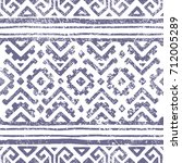 Seamless geometric pattern. Print for your textile. Ethnic and tribal motifs. Gray and white ornament. Grungy texture. Vector illustrations. | Shutterstock vector #712005289