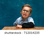 smiling caucasian boy wearing... | Shutterstock . vector #712014235
