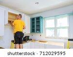 installation of kitchen. worker ... | Shutterstock . vector #712029595