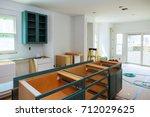 custom kitchen cabinets in... | Shutterstock . vector #712029625
