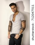 handsome tattooed young man...   Shutterstock . vector #712047511