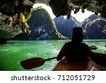 kayaking among caves and lagoon ... | Shutterstock . vector #712051729