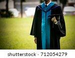 hand of graduate holding black... | Shutterstock . vector #712054279