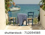 traditional greek blue table... | Shutterstock . vector #712054585