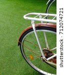 bicycle and grass field | Shutterstock . vector #712074721