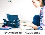 Female Photographer Sitting On...