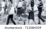 people shopping in the city in... | Shutterstock . vector #712084339