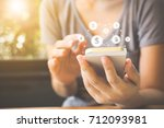 woman hand using mobile phone... | Shutterstock . vector #712093981