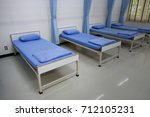 many nursing beds in factory. | Shutterstock . vector #712105231