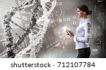 her biochemistry research and... | Shutterstock . vector #712107784