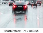 rainy road. driving cars on a... | Shutterstock . vector #712108855