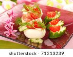 eggs stuffed with parma ham,cucumber,tomato and mayonnaise as appetizer for easter - stock photo
