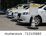 row of rental cars  | Shutterstock . vector #712135885