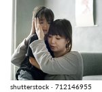 mother sooth her daughter from... | Shutterstock . vector #712146955