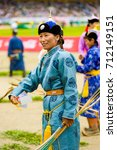 Small photo of Ulaanbaatar, Mongolia - June 11, 2007: Female archery competitor in traditional garb participating in opening ceremony of the Naadam Festival