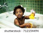 african descent kid enjoying... | Shutterstock . vector #712154494