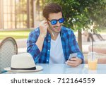 outdoor image of young smiling... | Shutterstock . vector #712164559