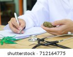 medicine doctor hand hold and... | Shutterstock . vector #712164775