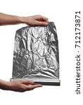 Small photo of close up of a an aluminum foil on white background