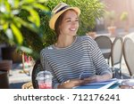 outdoor image of young pretty... | Shutterstock . vector #712176241