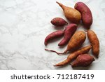 organic sweet potatoes | Shutterstock . vector #712187419