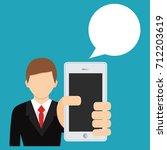 businessman holding smartphone. ... | Shutterstock .eps vector #712203619