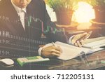 businessmen are taking notes  | Shutterstock . vector #712205131