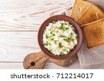 clay bowl of goat cream cheese... | Shutterstock . vector #712214017