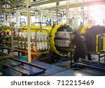 worker put white leather shoes... | Shutterstock . vector #712215469
