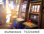 slot machines in a casino.... | Shutterstock . vector #712216465