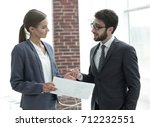 company's employees to discuss... | Shutterstock . vector #712232551